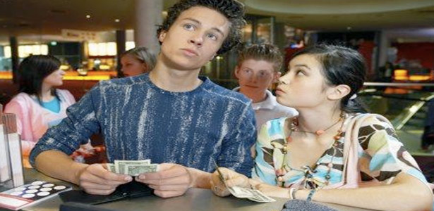 couple at movies deciding who should pay for date